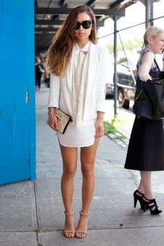 Fashiontoast's Rumi Neely in an all-white outfit and a Sandro pouch.   NYFW Street-Style Snaps