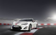 2014 Toyota Car Driving On Road - http://carwallpaper.org/2014-toyota-car-driving-road/
