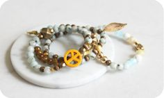 A beautiful set of 4 bracelets, made in Montreal. Perfect for an effortlessly cool and classy look How To Look Classy, Bracelet Set, Montreal, Beaded Bracelets, How To Make, Gold, Gifts, Blue, Beautiful