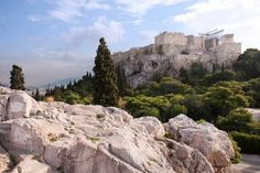 Areopagus - The great bald rock in Athens -The great bald rock that is the Areopagus sits high on a ridge that leads to the Acropolis.  Small Group Tour of the Acropolis, Acropolis Museum, & Agora  Legend has it that the war God Ares was tried here by the Olympian Gods for the murder of his cousin, a son of Poseidon, God of the sea, of earthquakes and of horses.
