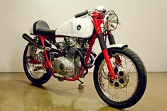 A very sweet Honda CL350 cafe racer from Lossa Engineering. Check that exhaust system closely ... it's a work of art.