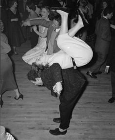 A couple rock 'n' rolling at a dance club in London.