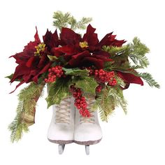 Faux holly, evergreen, and poinsettias arranged in an ice skates-shaped planter. brownFeatures: Includes poinsettia, berries and holly pointsSuitable for indoor Christmas Wreaths, Christmas Crafts, Christmas Ideas, Christmas Time, Country Christmas, Holiday Ideas, Christmas Centerpieces, Christmas Decorations, Christmas Arrangements
