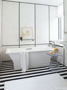 Linear accents supply bold impact. Bathtub and shelf, Kohler. Marble tile, Ann Sacks. Table, Plexi-Craft. Image originally appeared in the January/ February 2012 issue of Veranda. INTERIOR DESIGN BY S. RUSSELL GROVES