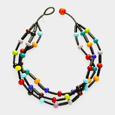Maasai Multicolor Glass Necklace by  Marina and Susanna Sent, 2011. The sisters continue the long-standing tradition of glasswork with their jewelry design, adding a contemporary flair to the timeless art form. This design is inspired by colors and necklaces worn by the Maasai people of Kenya and northern Tanzania. The three-strand necklace is made of glossy and satin glass beads and finished with a loop closure.