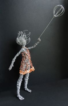 "Girl is 17"" tall; 22.5"" to top of balloon.  I made her using primarily 16 ga. galvanized steel and 18 ga. copper."