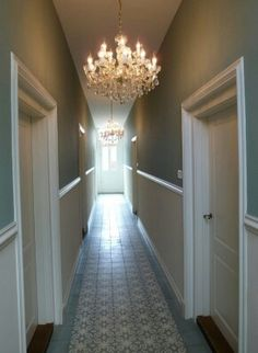 Modern Country Style: Ten Effective Decorating Ideas For Small, Narrow Hallways Click through for details. Modern Country Style: Ten Effective Decorating Ideas For Small, Narrow Hallways Click through for details. Hallway Paint, Dark Hallway, Long Hallway, Dado Rail Hallway, Hallway Chandelier, Hallway Lighting, Chandelier Ideas, Duck Egg Blue Wall, Victorian Hallway