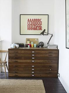 FAMILY ROOM - plan chest + typographic print + floorboards + white walls