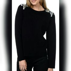 NWOT YAL Rhinestone Embellished Shoulder Top Beautiful black embellished shoulder top. Large rhinestones. Feels like soft luxe ponte knit. Cotton blend construction. Size XL but looks like a L. Can be worn by as a unique top for a large/xl or as a cool oversized top on someone smaller. YAL New York Sweaters