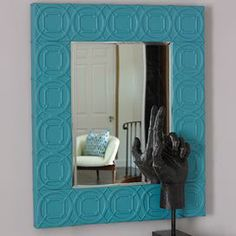 """Showcasing a stitched leather frame and trellis relief motif, this eye-catching wall mirror brings classic appeal to your entryway or master suite.  Product: Wall mirror Construction Material: Leather and mirrored glass Color: Turquoise frameFeatures: Trellis relief motifDimensions: 39.5"""" H x 32.5"""" W x 2"""" D"""