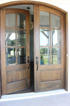 Double wood and glass arched front door with Oil-based stain by Sherwin Williams. - Double wood and glass arched front door with Oil-based stain by Sherwin Williams. Stained Front Door, Arched Front Door, Double Front Entry Doors, Wood Front Doors, Front Door Entrance, Arched Doors, House Front Door, Glass Front Door, Wooden Doors