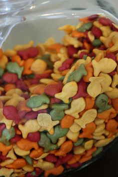 Gold fish snacks in a fish bowl