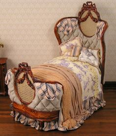 Another beautiful dressed bed from June Clinkscales French country dressed in blue toile with ticking accents $595