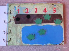 Busy Book. Pages coordinate with songs or rhymes such as Itsy Bitsy Spider and 5 Speckled Frogs.