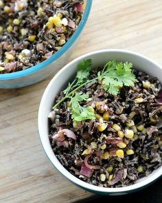 Earthy wild rice is paired with sweet spiced pecans, tangy feta, caramelized onions, and charred corn to make a flavor-packed main dish salad.
