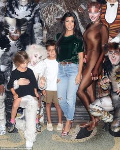 Kool Kats: Kourtney Kardashian, daughter Penelope and son Mason also posed with the cast