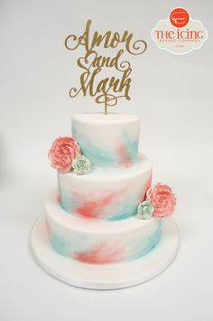 A watercolor inspired cake in coral and turquoise.