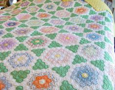 Beautiful antique grandmothers flower garden quilt. Circa 1930s.  I love this setting.