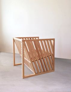 Designer Per Jensen's first exploration of the shape of a cube led to Anna Marta, a pine chair with angled slats that present a graphic pattern.