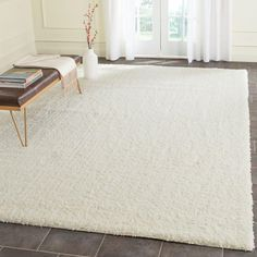 Safavieh Laguna Shag Ivory 8 ft. 6 in. x 12 ft. Area Rug - SGL303A-9 - The Home Depot