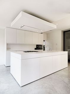 Kitchen inside the SH House by OpenBuildings. Clever way of concealing the air extractor above a kitchen island.