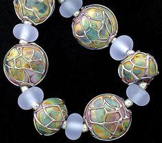 DSG Beads Handmade Organic Lampwork Glass-Made To Order Violet and Raku Lentils. $130.00, via Etsy.