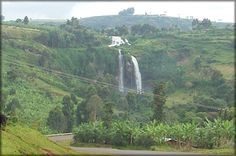 View of the Sipi Falls near Mount Elgon National Park, on the border of Uganda and Kenya. Book a three day tour to Sipi Falls where you can hike, take a coffee processing tour, abseil and rock climb.  Call +256 (0) 312-260-559 Or Email: info@pearlofafricatours.com, Website: pearlofafricatours.com with your questions and to book your trip today.