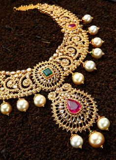 Rich uncut diamond necklace studded with rubies, square shaped emerald stone and golden brown south . India Jewelry, Pearl Jewelry, Wedding Jewelry, Antique Jewelry, Gold Jewelry, Jewelry Accessories, Diamond Jewellery, Gold Necklace, Emerald Necklace