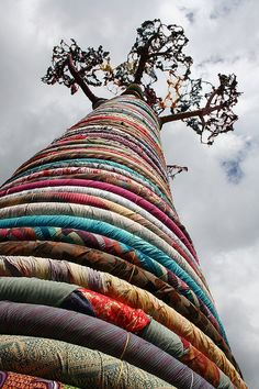 In London, a huge sculpture Baobob tree made out of rings of fabric reaches high.