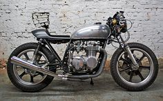 Honda CB550 cafe racer. Simple colours, great look. More brat style would work well too.
