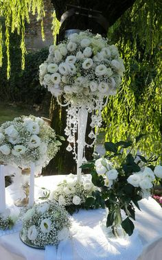 Beautiful wedding tall centerpiece with white Lisiantus and babies breath.