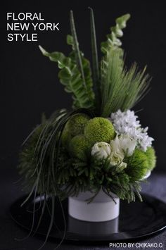 White and green floral arrangement by Floral New York