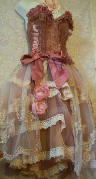 The skirt is so vintage!  I love it!  All the layers of sheer dusty rose edged with lace.  Absolute love! <3