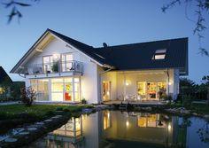 Klassisch L-Form Satteldach Freiraum für Freiheit: Modernes Einfamilienhaus von Gussek