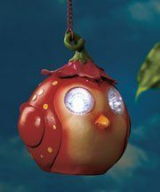 """Bird Solar Hanging Garden Light . $18.99. Bird Solar Hanging Garden Light. Hanging Bird Solar Light is an adorable creature who will brighten your porch, patio and more. Its big, shining eyes create enough light to mark your front door or a path. Energy from the sun powers the wireless light, so you can hang it almost anywhere. 6-3/4"""" x 6-1/4"""" x 5""""; hangs 14-1/2"""" long including hook and chain. Cold cast ceramic. Hang it from your gutter or porch overhang.  Set..."""