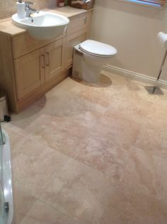 The natural variation in the Premium Classic Travertine adds interest and diversity to this customer's bathroom.