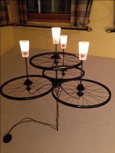 bicycle wheel chandelier - pint glasses