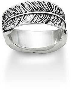 """Playful by design yet distinctive with detail, this unique ring wraps the finger with two feathers end-to-end. sterling silver 2 feathers approx. 0.3125"""" width Made in USA."""