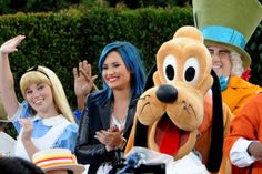 Singer Demi Lovato met Pluto, Alice and the Mad Hatter when she was co-hosting The View on November 19th at Disneyland. Rocking her blue hair, which we are still in love with, she promoted the release of her new book, Staying Strong, as well as showing off her comedic side. She's just so cute.