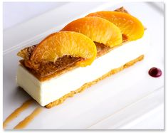 Peninsula Grill Executive Pastry Chef Claire Chapman's crispy, flaky, and light-as-air Peach Napoleon. #dessert #peaches #Charleston #pastry #delicious #PeninsulaGrill