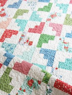 This quilt just looks like the month of March…all springy and March-y (?). Anyways…this one is my favorite out of the new bunch of quilts. I've made this 3 times already from layer cakes, and it…