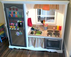 DIY Play Kitchen from an old entertainment center/wardrobe | Andrea Dekker (those plastic ones are less durable and really expensive)