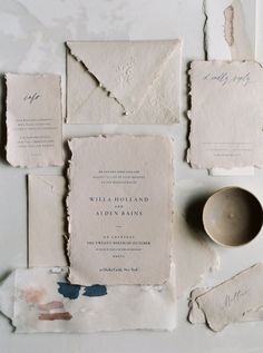 Organic, torn edged wedding invitations.