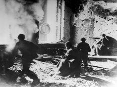 Russian soldiers target the Germans from within an abandoned building during the Battle of Stalingrad, World War II, circa 1942. The soldier in motion on the left was killed before he reached the window.  (Photo by Archive Photos/Getty Images) Photo: Archive Photos/Getty Images