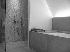 Grey bathroom with indirect lighting by Peter Ivens