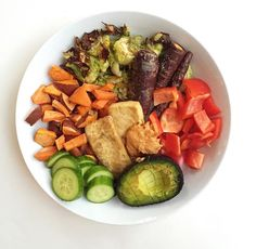 roasted carrots and brussel sprouts, sweet potatoes, cucumbers, chipotle hummus, crispy tofu, fresh bell pepper & 1/2 an avocado