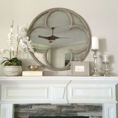Restoration Hardware Quatrefoil Mirror.             For the living room