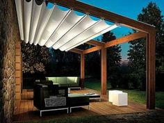 White Canvas Shade Pergola Featuring Wooden Canopy And Contemporary Coffee Table Plus Laminate Wood Flooring Together With Modern House Decoration.