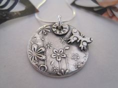 Round Butterfly & Flower Necklace by InDeeDesigns on Etsy, $30.00