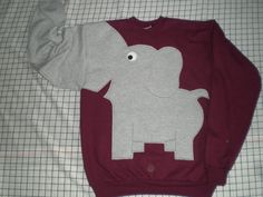 UPcycled from NEW sweatshirts, crew neck sweatshirt in a cotton polyester blend with elephant applique and trunk sleeve. All my appliques are